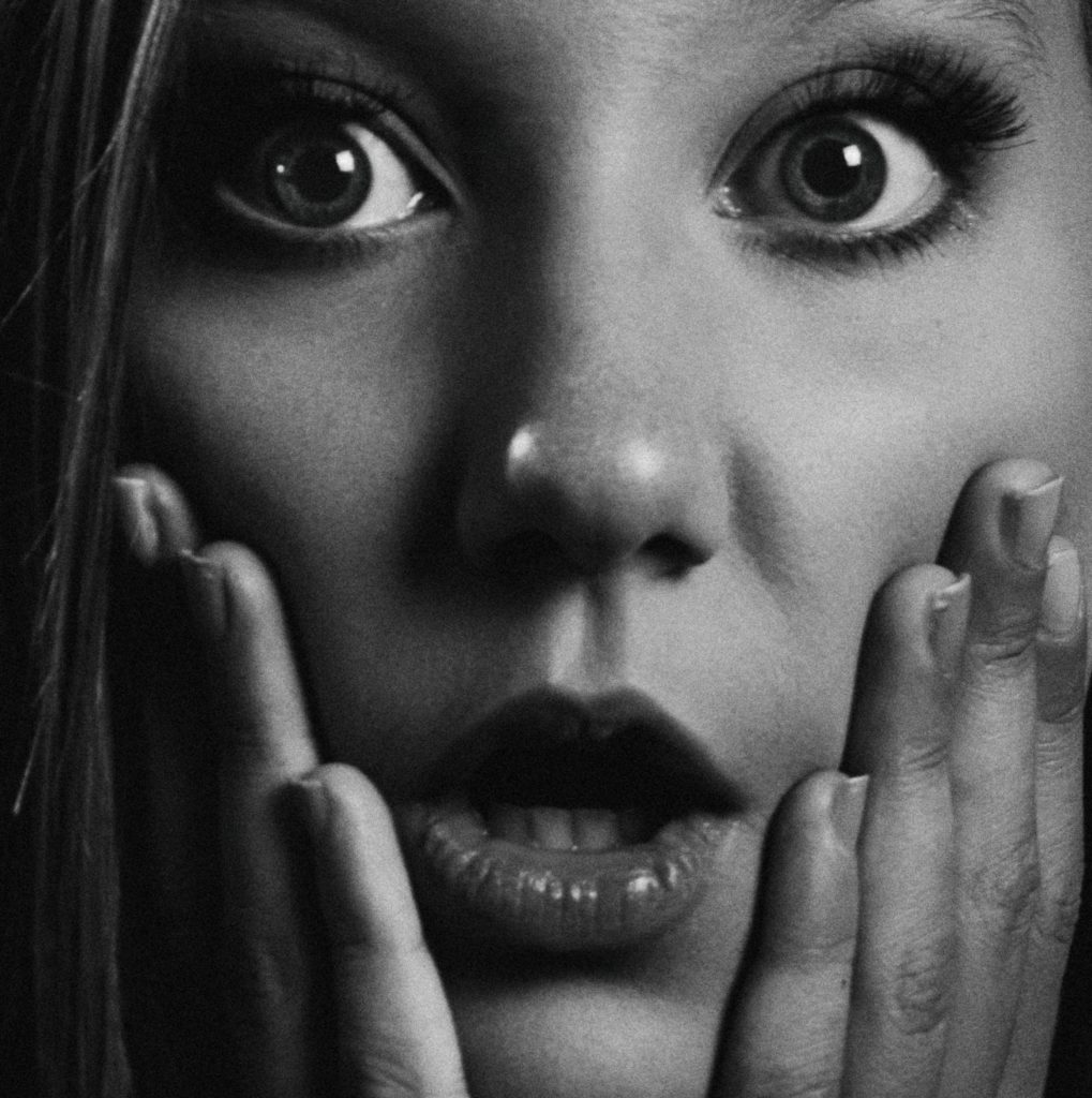 Woman making a surprised face, use emotional hooks in your title.