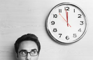 man looking at a clock in black and white