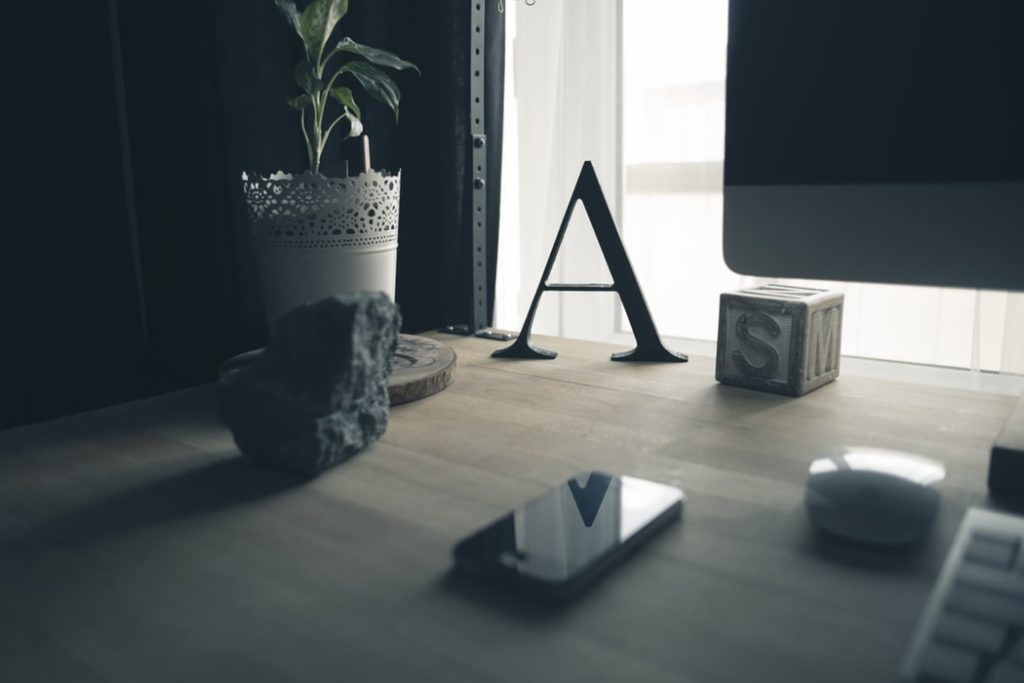 letter A on a desk