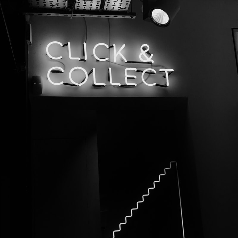 click & collect written in neon sign