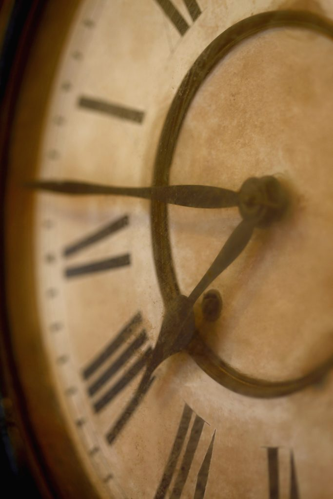 aged clock, only half the face