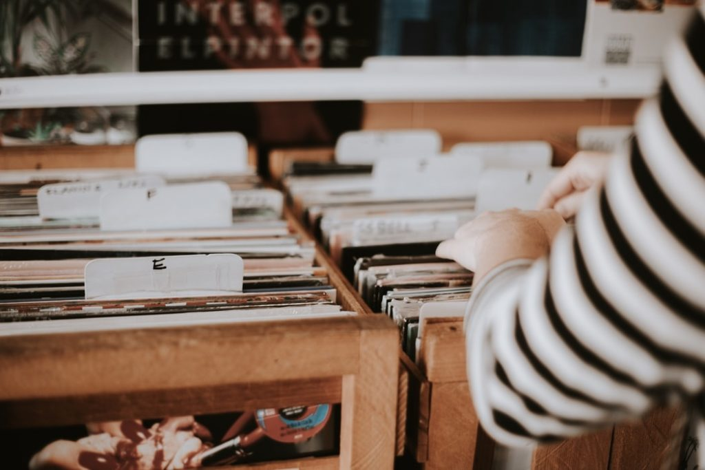 girl searching through vinyl records