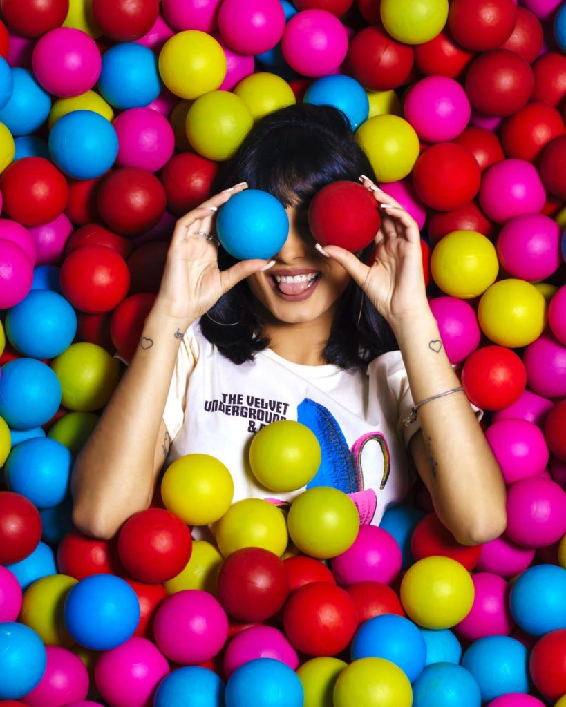 girl in colorful ball pit
