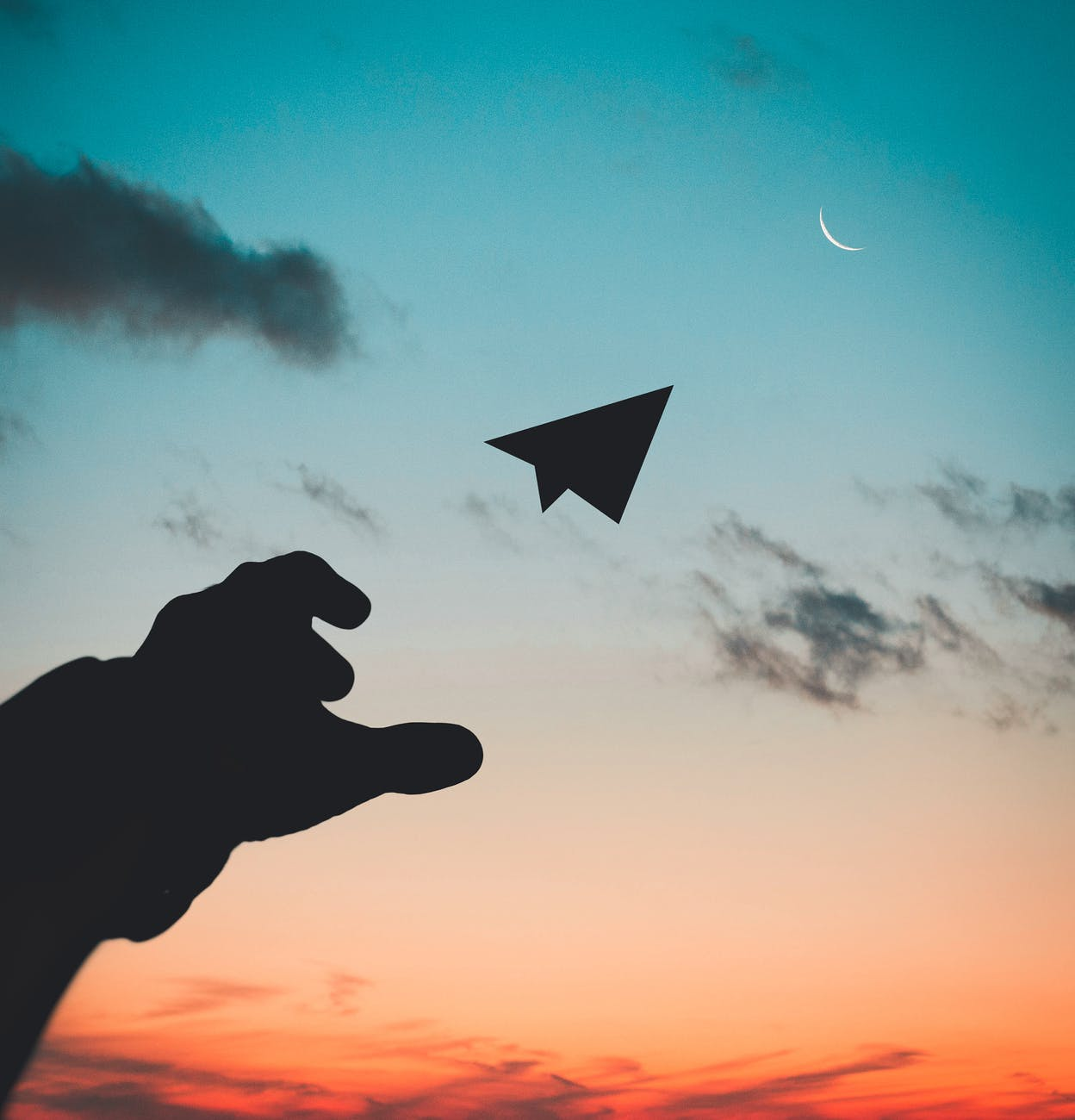 throwing a paper airplane at the sky