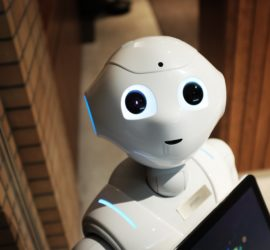 robot looking up with a happy face