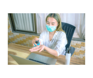 COVID's Impact on Digital Marketing   Woman Sanitizing in Front of Work Computer