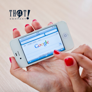 Google Marketing | A Hand Holding A Phone Showing Google Search Bar
