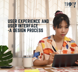 User Experience and User Experience | A Girl Holding A Tablet In Front Of A Table With Layouts For Designing