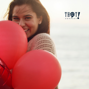 Do What You Love As Creative Marketer | A Woman Brightly Smiling While Holding A Red Balloon