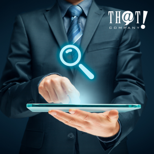 Knowing The Business In a SEO Strategic Plan Setup | A Hand Holding A Tablet with A Hologram of a Magnifying Glass