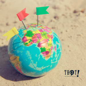 Local SEO For Google My Business | A Small Globe At the Sand With 3 Flags Colored Yellow, Red and Green Pinned At Different Map Locations