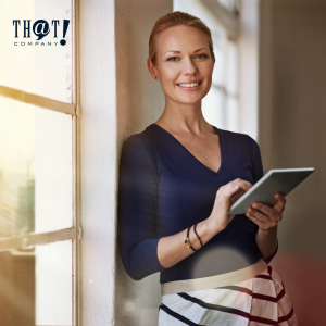 Local SEO for Business | A Woman Holding A Tablet Leaning on the Wall