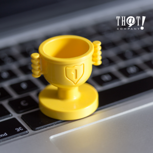 Benefits of SEO | A Yellow Toy Trophy at the Top of A Laptop