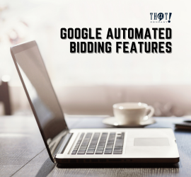 Automated Bidding | A Laptop On The Top Of The Table With a Cup of Coffee and a Notebook at the Side.